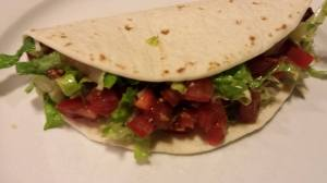 Shredded Buffalo Taco with Monterey Jack Cheese, Shredded Lettuce, and Diced Ripe Tomato (Photo Credit: Adroit Ideals)