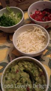 Taco Fixin's: Shredded Monterey Jack, Shredded Lettuce, Diced Tomato with Cilantro, and Guacamole (Photo Credit: Adroit Ideals)