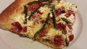 Top the pizza with some shredded Parmesan (Photo Credit: Adroit Ideals)