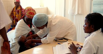 Nurse in a local clinic in huambo province angola checks a patie