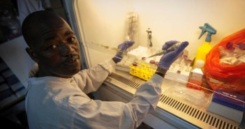 Photo credit: WHO/S. Hawkey. Mamadouba Conté, working in the Ebola lab at Donka Hospital.