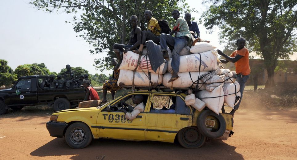 "People leave the Damara, the last strategic town between the rebels from the SELEKA coalition and the country's capital Bangui, on January 2, 2013, as the commader of the regional African force FOMAC warned rebels against trying to take the town, saying it would ""amount to a declaration of war."" The rebels, who began their campaign a month ago and have taken several key towns and cities, have accused Central African Republic leader Francois Bozize of failing to honor a 2007 peace deal. The sign reads in French ""The seductive city of Damara welcomes you and wishes you a pleasant stay.""    AFP PHOTO/ SIA KAMBOUSIA KAMBOU/AFP/Getty Images"