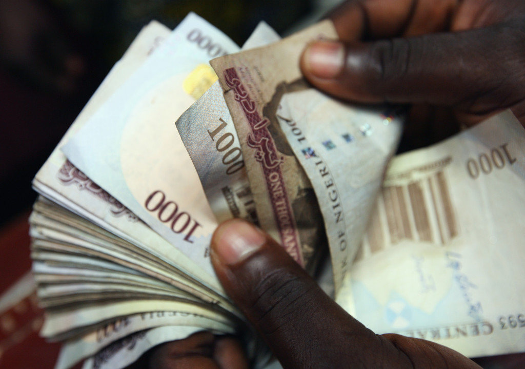 LAGOS, NIGERIA - JULY 15:  A detail of some Nigerian Naira,(NGN) being counted  in an exchange office on July 15, 2008 in Lagos, Nigeria.  (Photo by Dan Kitwood/Getty Images)