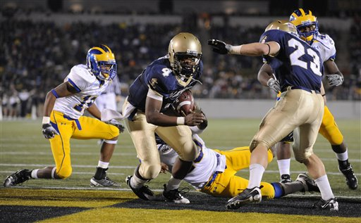 Navy's Ricky Dobbs scores a touchdown against Delaware in the second half of Navy's 35-18 win over Delaware. (AP Photo/Gail Burton