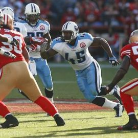 Tennesse Titans fullback Ahmard Hall, a former sergeant in the Marine Corps, leads tailback Chris Johnson on a running play against San Francisco.