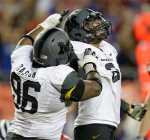 Missouri defensive end Brian Coulter (2) and defensive lineman Jaron Baston are part of a defensive front that will have its hands full shutting down Ricky Dobbs and the Navy offense.  (AP Photo/Orlin Wagner)