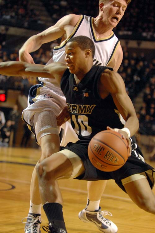 Army's Marcus Nelson drives past Navy's Jeremy Wilson. (Tom Brown / Staff)