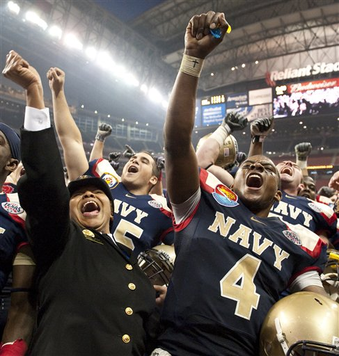 Navy quarterback Ricky Dobbs celebrates with Vonn Banks, left, following the Midshipmen's win in the Texas Bowl against Missouri. (AP Photo/Dave Einsel)