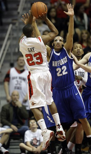 San Diego State's D.J. Gay gets a shot off over Air Force's Avery Merriex. (AP Photo/Lenny Ignelzi)