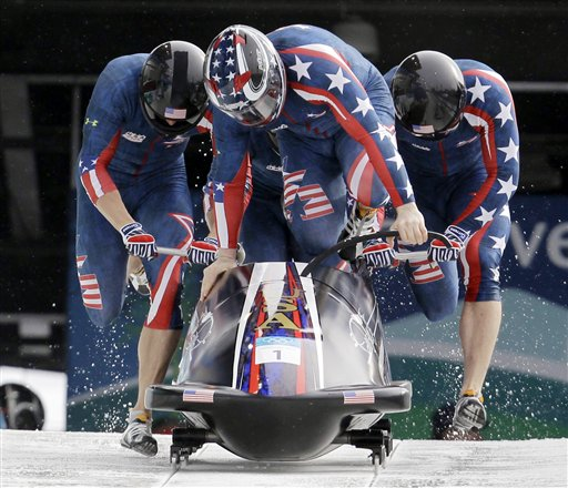USA-1, with Steven Holcomb, Justin Olsen, Steve Mesler, and Curtis Tomasevicz, start the third run during the men's four-man bobsled final competition in Whistler, British Columbia, on Saturday. (AP Photo/Andrew Medichini)