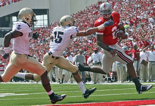 Terrelle Pryor scores a touchdown in the Buckeyes' 31-29 win over Navy in Sept. 2009. (AP Photo/Terry Gilliam)