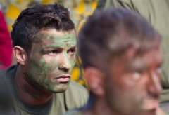 Portugal soccer player Christiano Ronaldo takes a break during Portugal Air Force training session. AP photo.