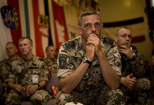 German soldiers watch their team play against Serbia at World Cup soccer, Friday, June 18, 2010 at their base in Kunduz, Afghanistan. (AP Photo/Dusan Vranic)