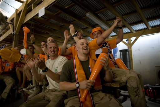 Dutch soldiers react as they watch Netherlands play against Denmark at World Cup soccer in South Africa, at their camp in Tarin Kowt, Uruzgan province, south of Kabul, Afghanistan, Monday, June 14, 2010. (AP Photo/Dusan Vranic)