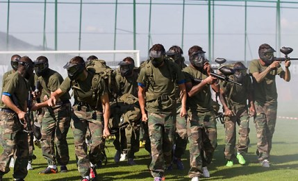 Portugal's national team thinks paint balling will help them exit the Group of Death. AP photo