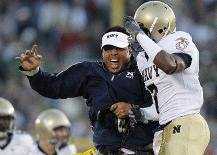 Coach Ken Niumatalolo celebrates after Navy beat Notre Dame last season. (AP photo)