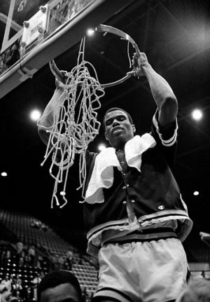 Navy's David Robinson takes off the net after Navy beat George Mason 72-61 to win the Colonial Athletic Association Tournament in Fairfax, Virg., on March 5, 1986. (AP Photo/Tom Reed)