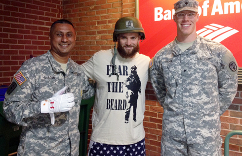 Army Master Sgt. Miguel Chacon, left, and Spc. Travis Crook flank Red Sox outfielder Jonny Gomes at Fenway Park on Sept. 15, after Chacon gave Gomes the helmet he had worn in Iraq. Chacon and Crook are with the U.S. Army Research Institute of Environmental Medicine at Natick Soldier Systems Center, Mass. (Army)