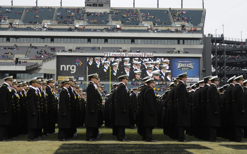U.S. Naval Academy Midshipmen march on the field before the 114th Army-Navy football game at Lincoln Financial Field in Philadelphia, Pa., on Saturday, December 14, 2013. (Mike Morones/Staff)