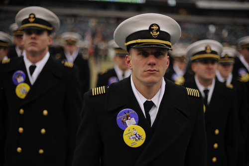 Naval Academy Midshipmen march on the field before the 114th Army-Navy football game at Lincoln Financial Field in Philadelphia, Pa., on Saturday, December 14, 2013. (Mike Morones/Staff)
