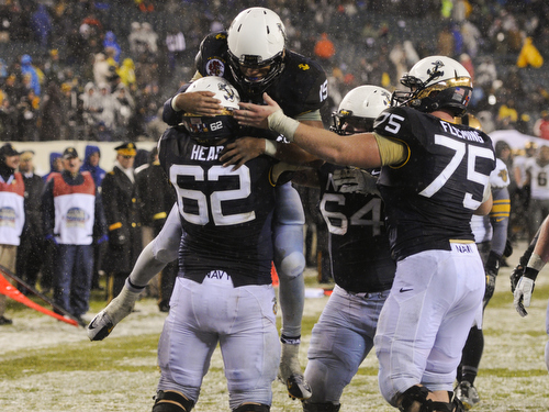 Quarterback Keenan Reynolds celebrates his second of three touchdowns against Army. The Midshipmen won 34-7. (Mike Morones/Staff)