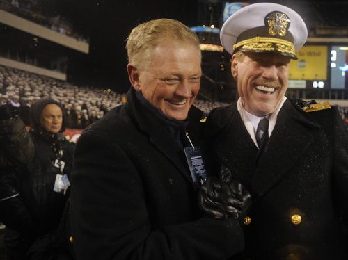 Naval Academy superintendent Vice Admiral Michael H. Miller and athletic director Chet Gladchuk celebrate navy's twelfth-straight win over Army in the 114th Army-Navy football game at Lincoln Financial Field in Philadelphia, Pa., on Saturday, December 14, 2013. (Mike Morones/Staff)