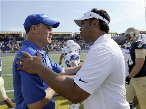 Air Force coach Troy Calhoun, left, has the Falcons atop the service academy standings this season, but Navy's Ken Niumatalolo, right, takes home top dollar. (Associated Press photo by Nick Wass)