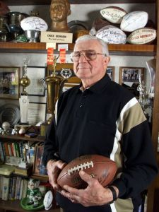 Chuck Bednarik, former B-24 waist gunner, poses with some of his hard-earned NFL hardware in 2011 (USA Today photo by Eileen Bass)