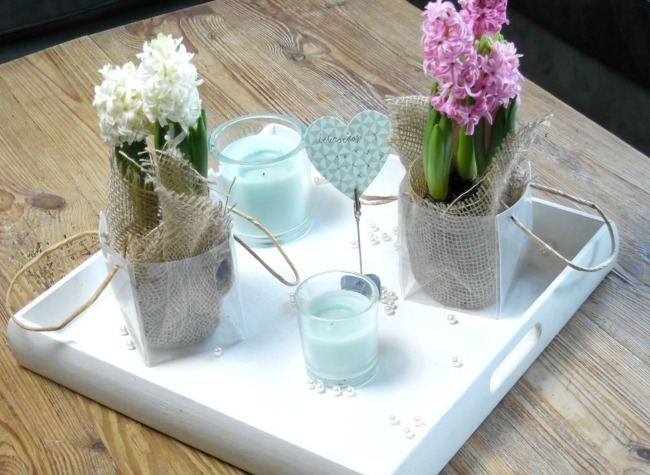 Spring Coffee Table Display Consisting Of Hyacinths And Candles
