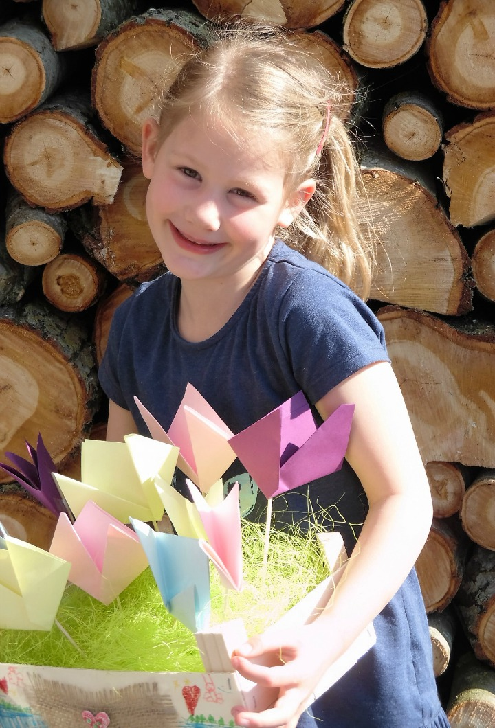 Child With Recycled Clementine Box And Hand Made Paper Flowers
