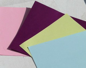 paper squares laid out ready for craft activity