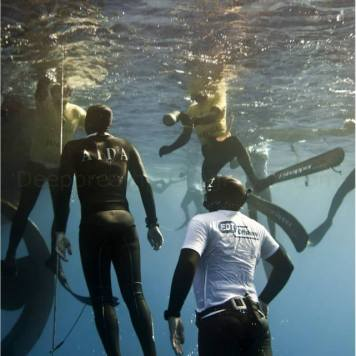 Moments before breaking the surface water, AIDA Judges and safetry divers scramble