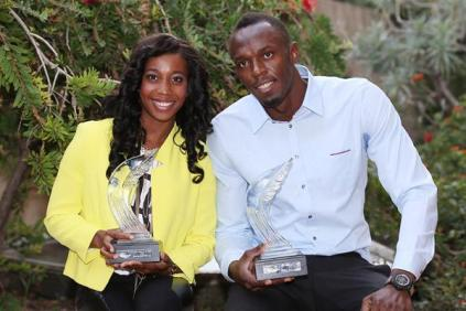 Usain Bolt and Shelly-Ann Fraser-Pryce pose after winning World Athele of the Year 2013