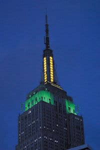 The Empire State Building in NYC on August 6th in the color of the Jamaican Flag