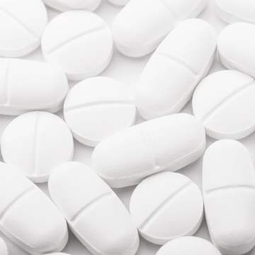 white pills and tablets: GMiA