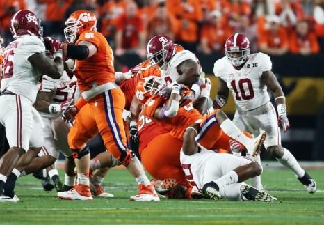 Crimson Tide defense makes a play. (Kent Gidley/UA Athletics)