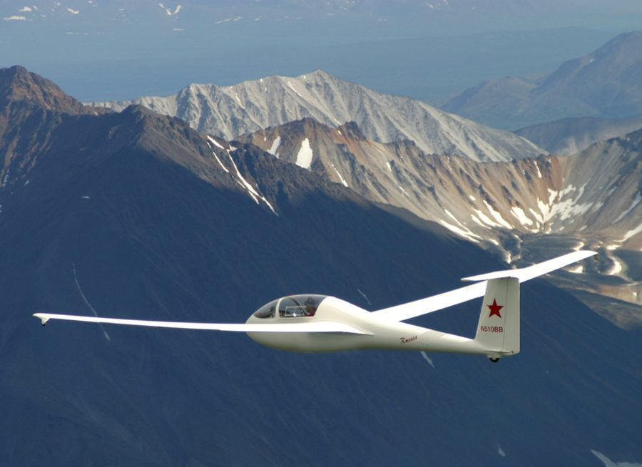 Glider flying above mountains
