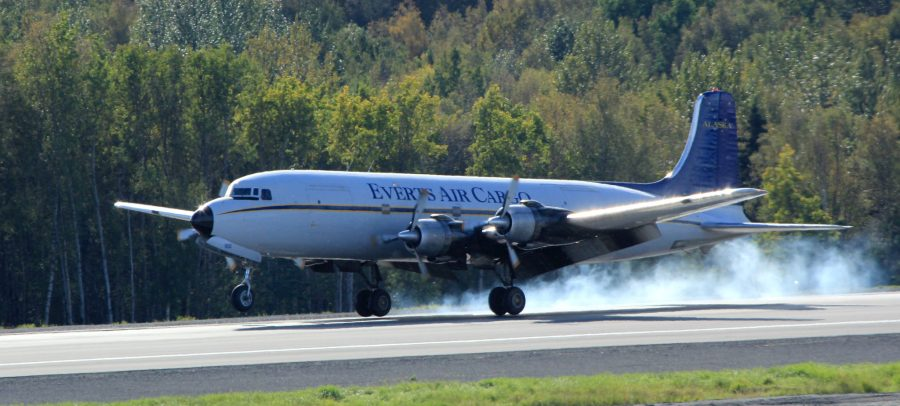 DC6 landing with smoke behind the tires.
