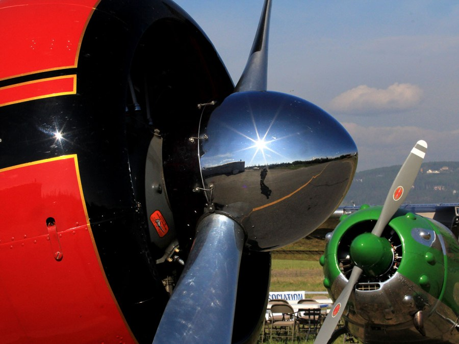 Side shot of a propeller and radial engine cowling.