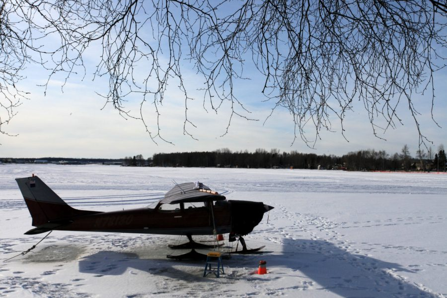 Plane on skis on a frozen lake. Photo by Rob Stapleton/Alaskafoto