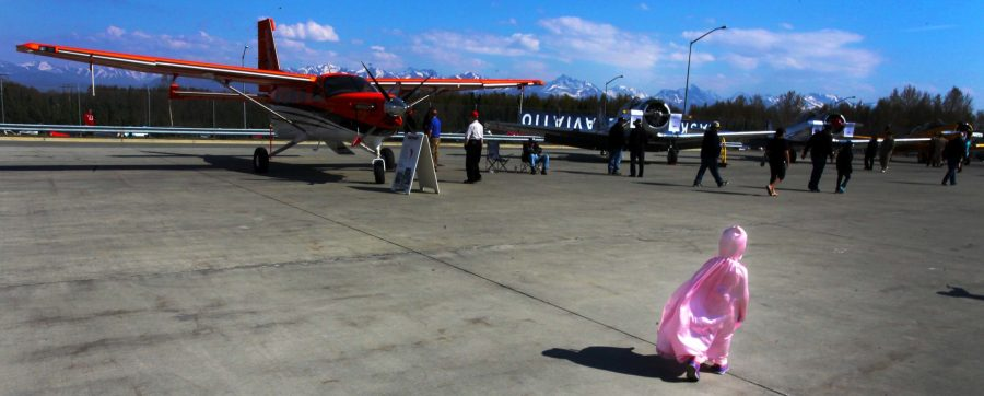 Girl in pink walking on the ramp at Ted Stevens Anchorage International Airport. Photo by Rob Stapleton