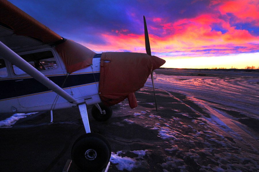Cessna 185 with fall sunset at PABV
