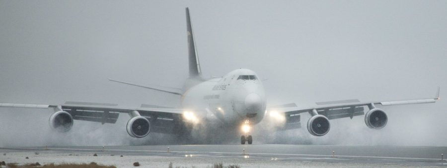 Jet landing in snowy wet conditions at PANC