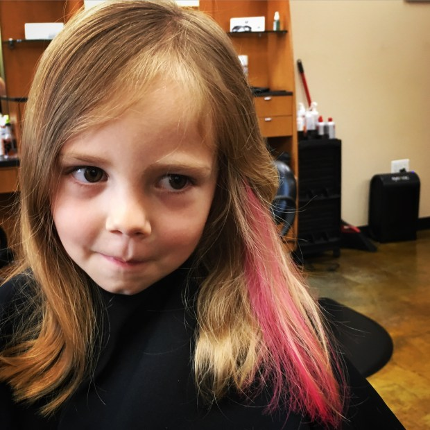 Now she's trying NOT to smile...a little pink was all it took!