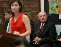 Georgia Gov. Sonny Perdue, right, listens to Kathleen Mathers, Executive Director of the Governor's Office of Student Achievement, point out suspicious data regarding state standardized test scores to the state school board Wednesday, Aug. 18, 2010 in Atlanta . (AP Photo/John Amis)