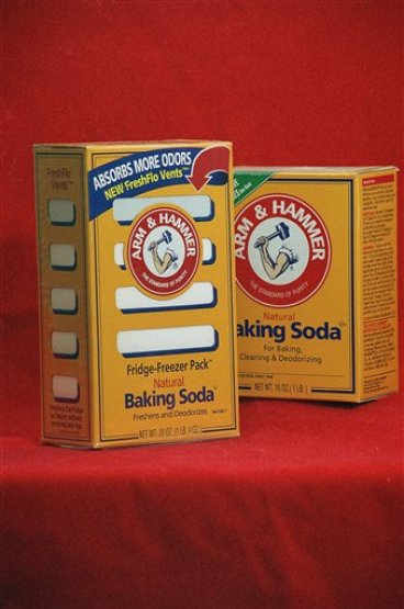 Arm & Hammer Baking soda boxes are shown in this undated photo. The distinctive yellow boxes deodorizing most American refrigerators and freezers. (AP Photo/Richard Drew)