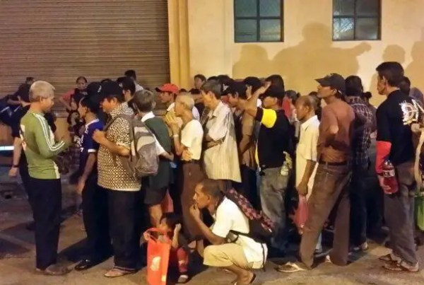 homeless-people-queue-at-a-soup-kitchen