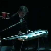 "November 23: Bob Dylan performs ""It takes a lot to laugh, It takes a train to cry"", London, England in 2003 (Video)"