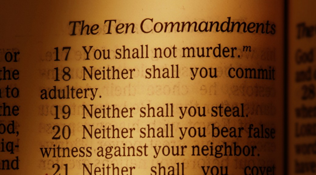 Page in the Bible showing part of the Ten Commandments