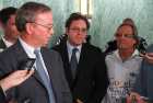 Eric Schmidt (L) with Alan Davidson and an unidentified mime